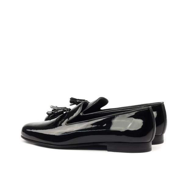 Black patent slippers with patent tassels