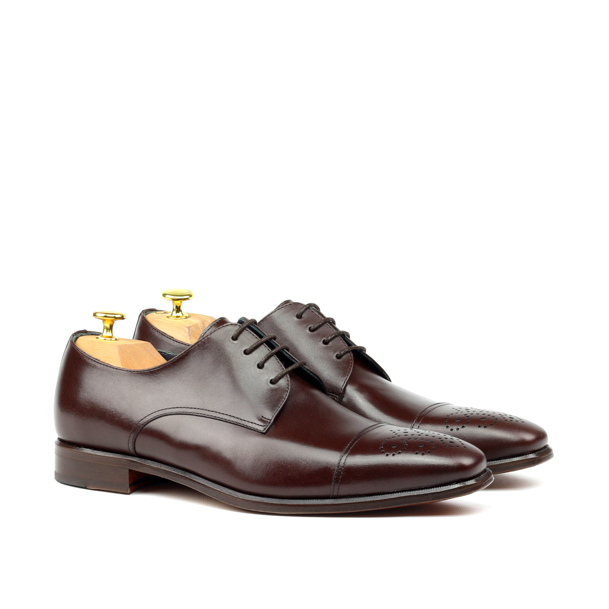 Brown punched cap toe derby